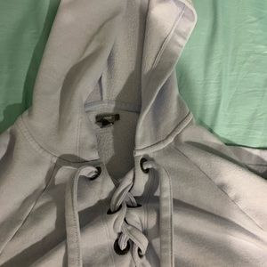 lace up blue hoodie